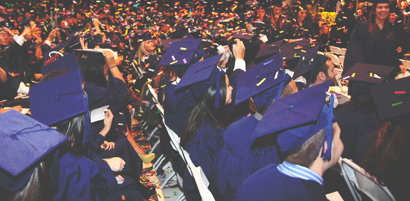 Florida International University (FIU) students celebrating graduation ceremony.
